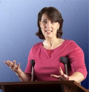 Marianne DiBlasi speaking at podium