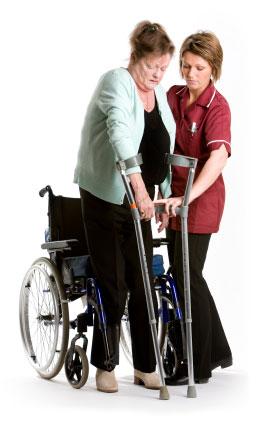 therapist helping woman walk